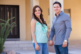 Newlyweds arriving to their new house — Stock Photo