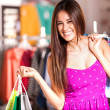 Young woman in a shop buying clothes — Stock Photo #30713725