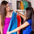 Two happy women shopping in clothes store — Stock Photo