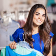 Young woman in a shop buying clothes — Stock Photo #30713059