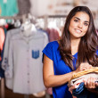Young woman in a shop buying clothes — Stock Photo #30713131