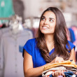 Young woman in a shop buying clothes — Stock Photo #30713169