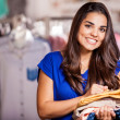 Young woman in a shop buying clothes — Stock Photo #30713175