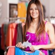 Young woman in a shop buying clothes — Stock Photo #30713323