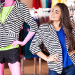 Smiling womand mannequin in same clothes — Stock Photo #30713333