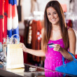 Woman at the checkout paying by credit card — Stock Photo