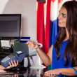 Stock Photo: Shopping womat checkout paying by card
