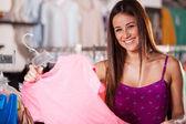 Beautiful woman shopping in clothing store — Stock Photo