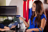 Shopping woman at the checkout paying by card — Stock Photo