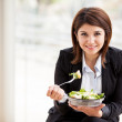 Portrait of business woman having fresh salad of vegetables — Photo #31407227