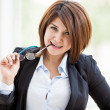 Young sexy business woman biting her glasses — Stockfoto