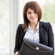 Image of beautiful business womwith portfolio — Stock Photo #31408099