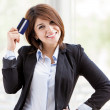 Closeup portrait of cute young business woman smiling while holding credit card  — Stock Photo