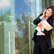 Young happy business woman calling on the phone — Stock Photo