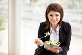 Portrait of business woman having fresh salad of vegetables — Stock Photo