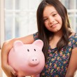 Little girl with a piggy-bank — Stock Photo #32535315