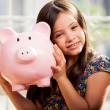 Little girl with a piggy-bank — Stock Photo #32535317