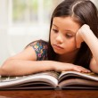 Stock Photo: Cute little girl reading book