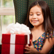 Cute little girl holding a gift — Stock Photo