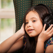 Young girl wearing headphones — Stock Photo
