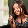 Little girl listening music on phone — Stock Photo