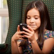 Stock Photo: Cute little girl holding cell phone