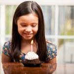 Beautiful little girl celebrates birthday. — Stock Photo