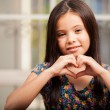 Little girl makes a gesture in the form of the heart — Stock Photo