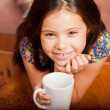 Little girl with a cup — Stock Photo