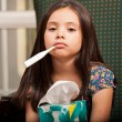 Little girl with thermometer into mouth — Stock Photo #32535791
