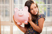 Little girl with a piggy-bank — Stock Photo