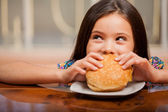 Little girl eating a sandwich — Stock Photo