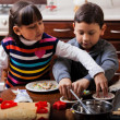 Children making christmas cookies — Stock Photo
