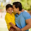 Father holding his son outdoors — Stock Photo