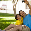 Son and his father taking a photo of themselves — Stok fotoğraf