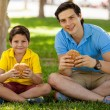 Father and his son holding sandwiches — Stock Photo