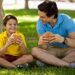 Father and his son holding sandwiches — Stock Photo #34549551