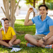 Dad and son launch paper plane — Stock Photo