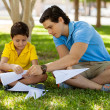 Father and his son making paper plane — Stock Photo