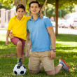 Father and his son with foot on soccer ball — ストック写真