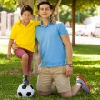 Father and his son with foot on soccer ball — Stock Photo