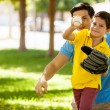Cute boy playing baseball with his father — Stock Photo