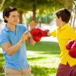 Father and his son is boxing with boxing gloves — Stock Photo