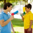 Father and son with toy guns — Stock Photo