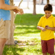 Father and son playing with yo-yo — 图库照片 #34549805