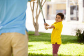 Son playing baseball with his father — Stock Photo