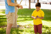 Father and son playing with yo-yo — Stock Photo