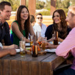 Friends having fun at a bar — Stock Photo #34985605