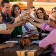 Having drinks and snacks at a bar — Stock Photo #34985649