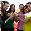 Friends making a toast at a bar — Stock Photo #34985905